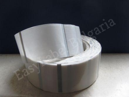 Прозрачен самозалепващ се стикер от PVC фолио, 30mm х 20mm /1/ 3 500бр., Ø76mm